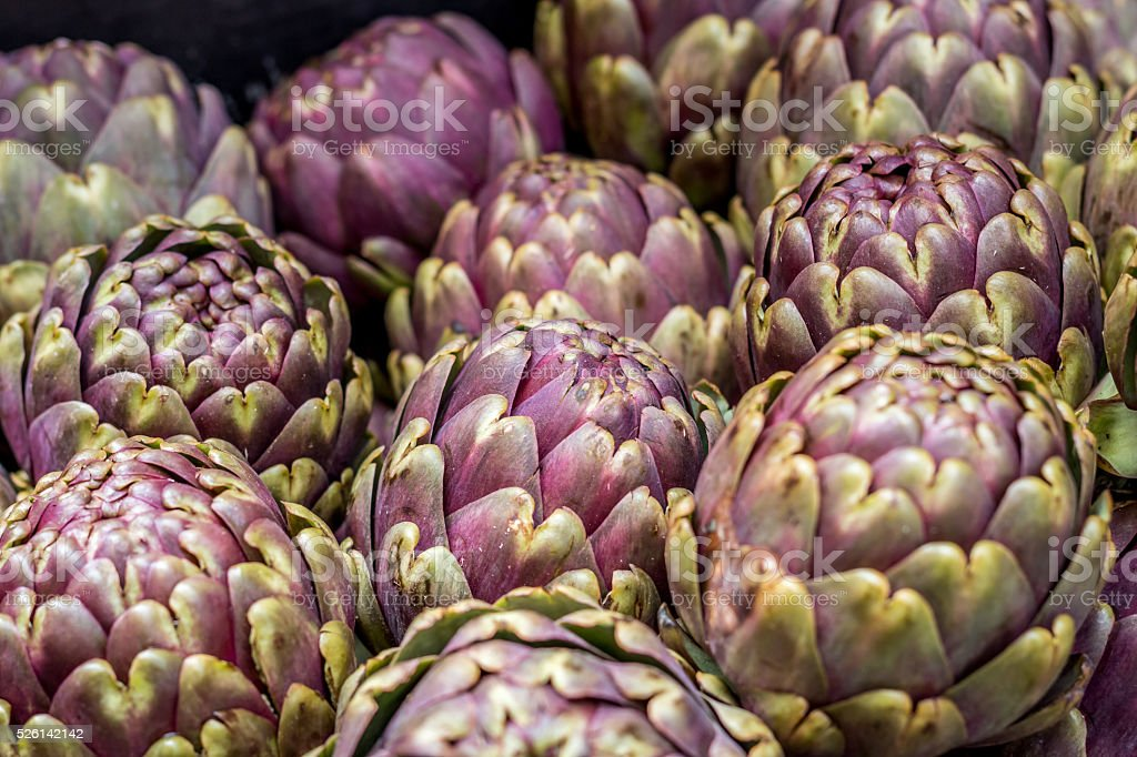 lots of artichokes in the market stock photo