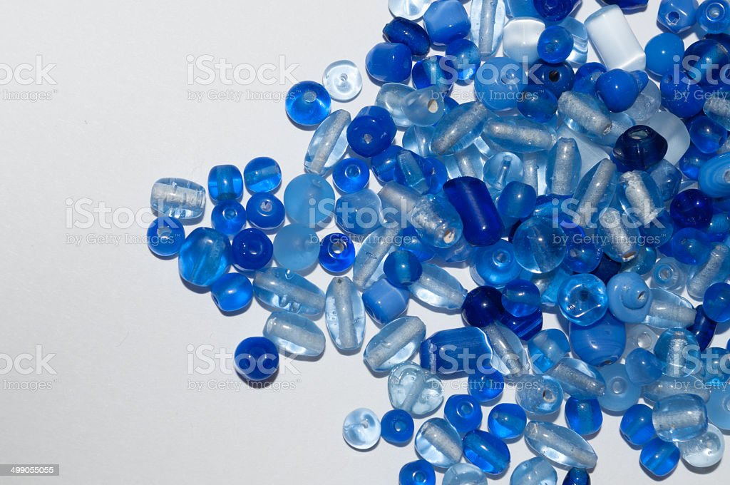 Lots of blue beads on white background royalty-free stock photo