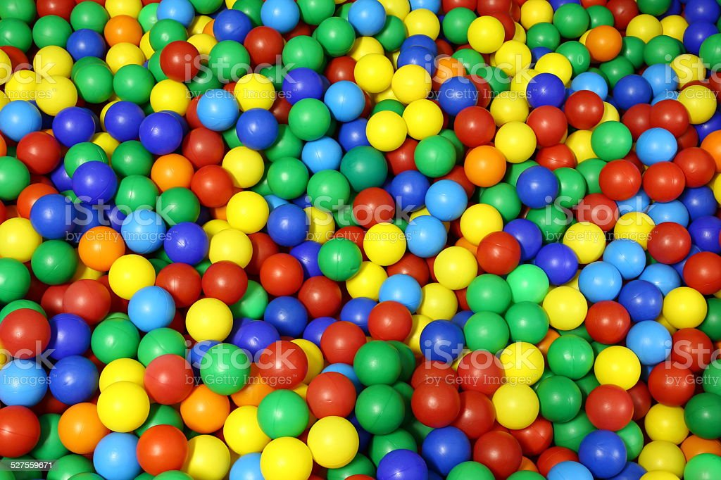 lots of blue green red yellow colored spheres stock photo