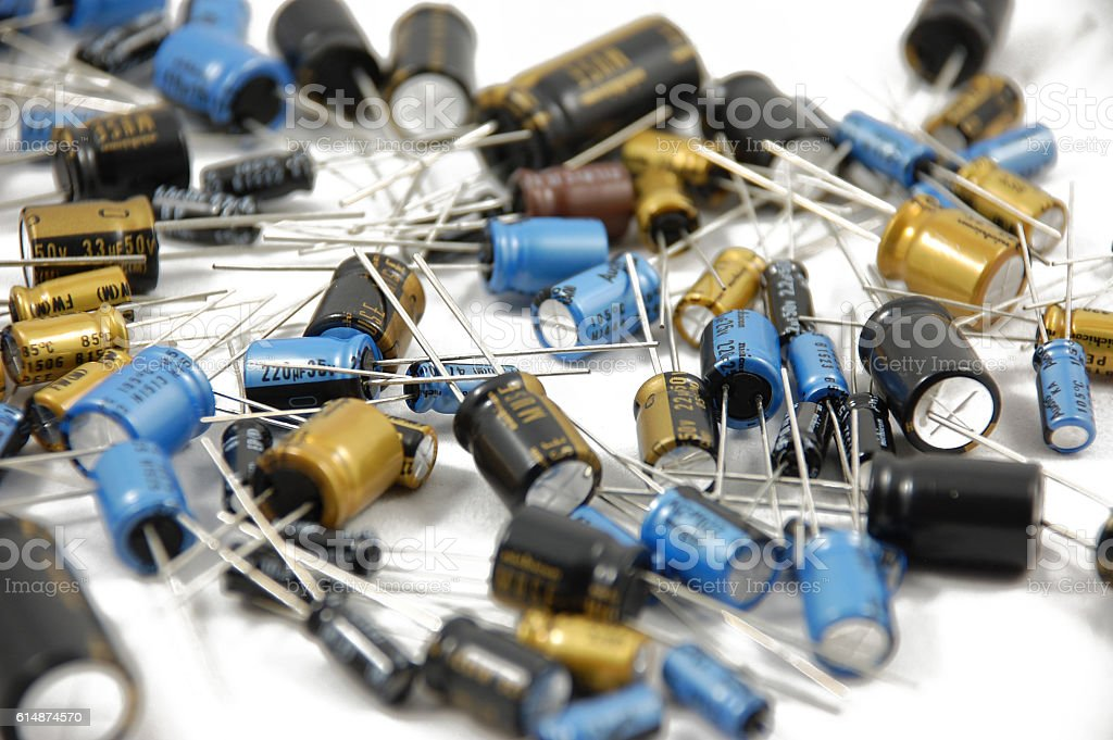 Lots of capacitors on white background wallpaper stock photo