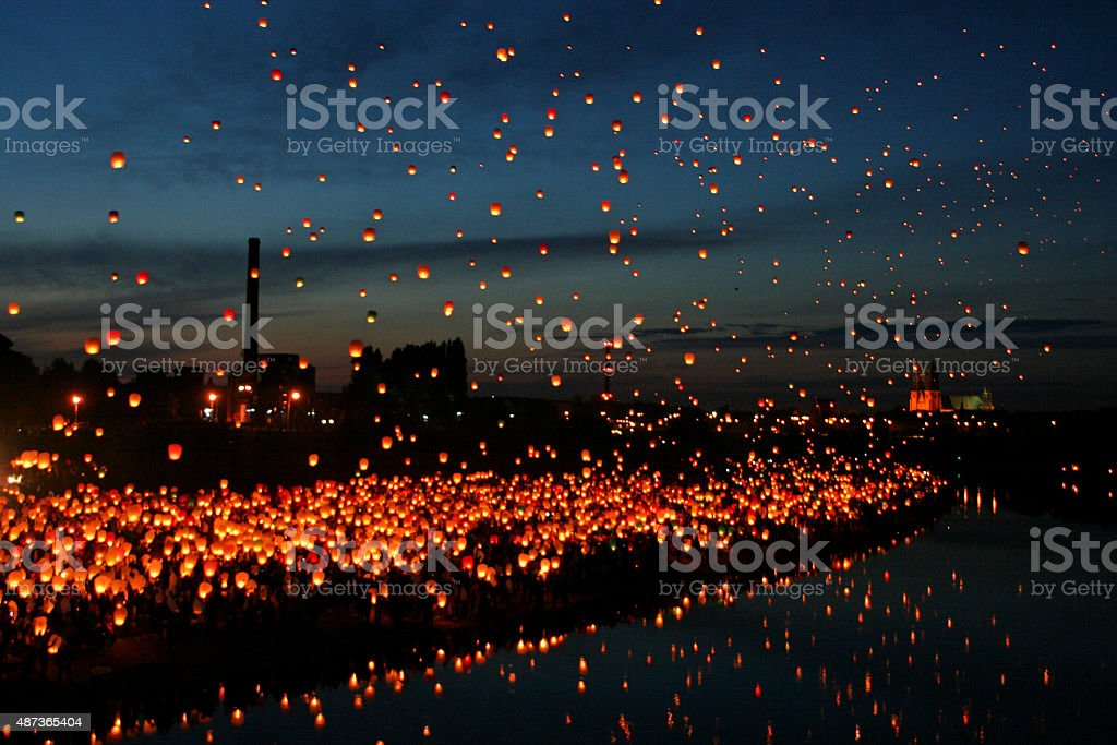 Lots of Chinese Fly Lanterns, next to the River. stock photo