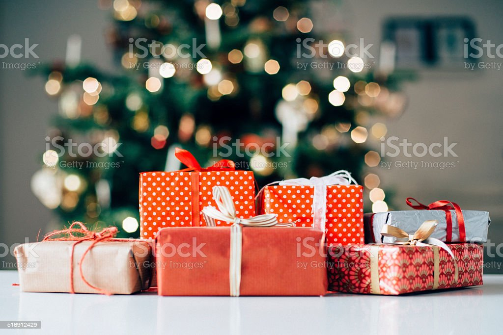 Lots of christmas presents on a table stock photo