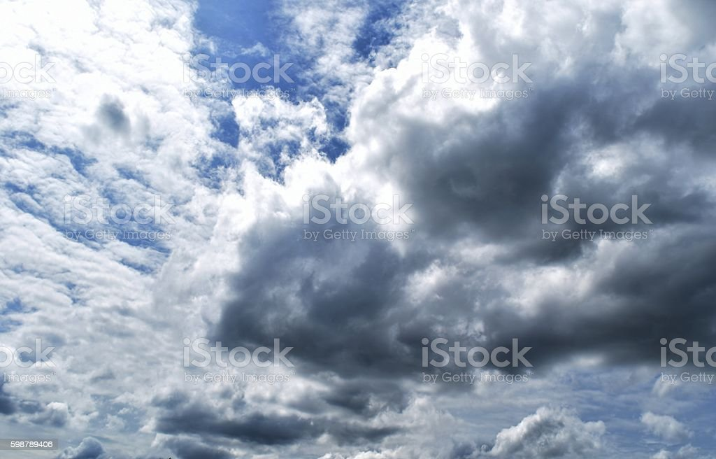 Lots of clouds moving in  sky during rainy season stock photo