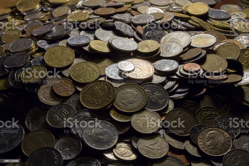 Lots of coins, pot of money stock photo