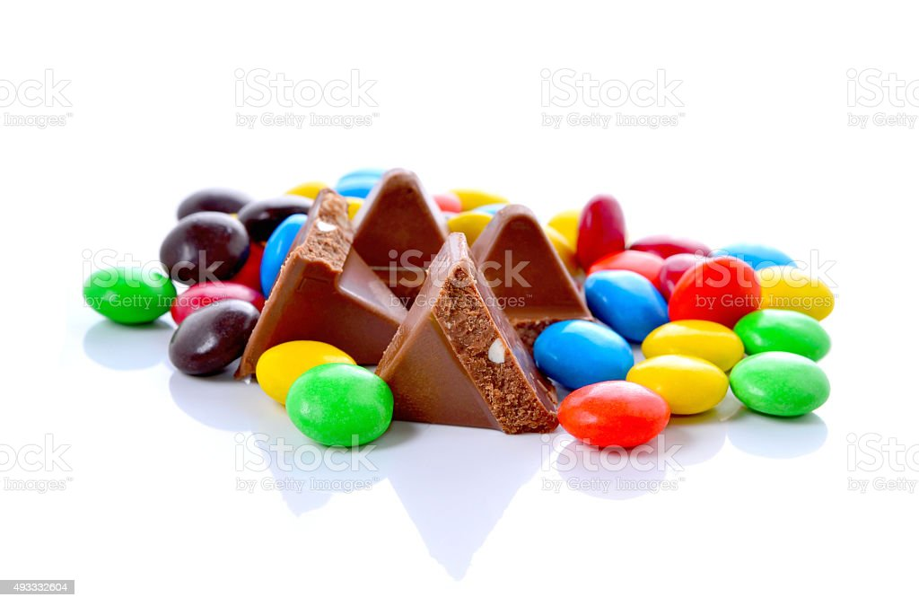 lots of colorful candies spread on white background stock photo