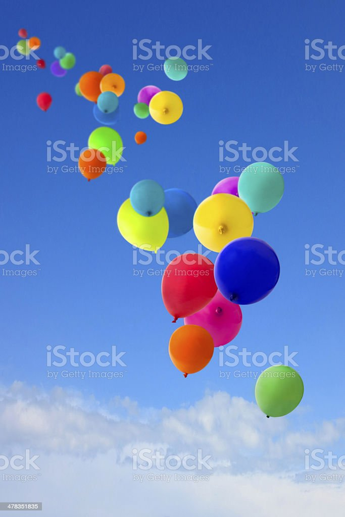lots of coloured balloons flying into the sky stock photo