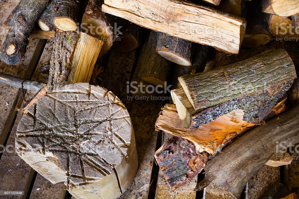 Lots of firewood lying on the street stock photo