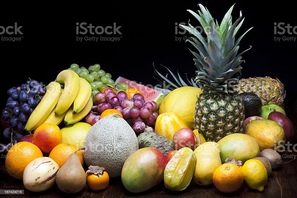Lots of fruits on black background royalty-free stock photo