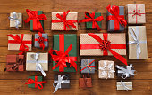 Lots of Gift boxes on wood, christmas presents in paper