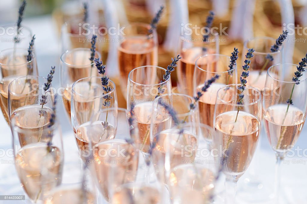 Lots of glasses filled with pink champagne stock photo