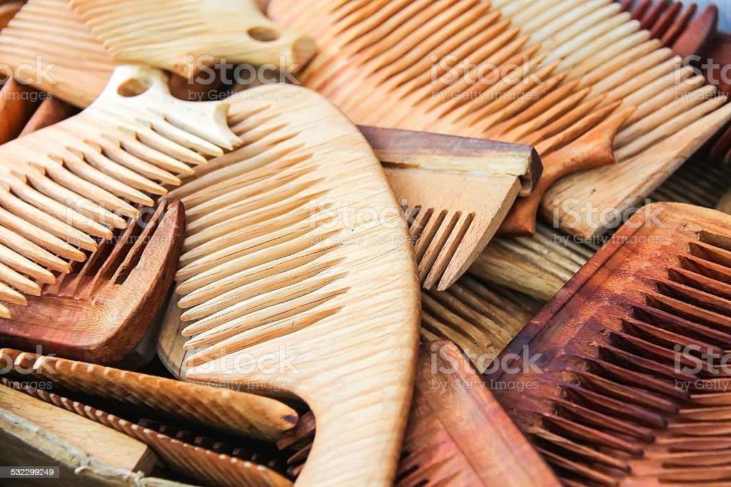 Lots of hand made wooden comb closeup stock photo