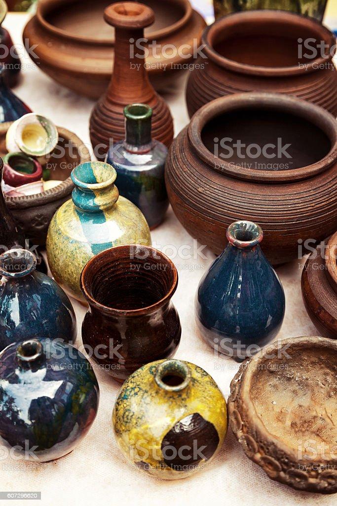Lots of handmade earthenware. Ceramic pots, vases at pottery shop stock photo