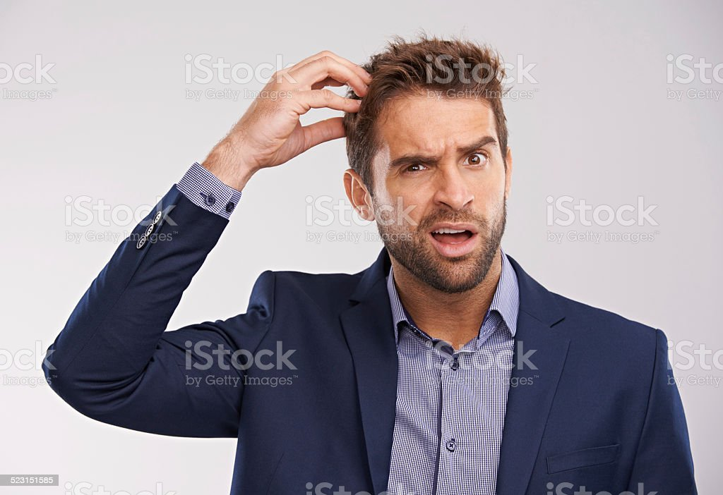 Lots of head-scratching is going on stock photo