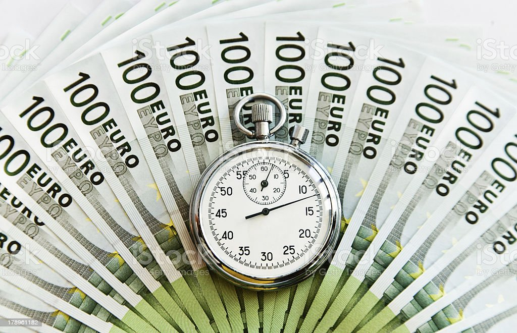 Lots of hundred Euro bills and watch royalty-free stock photo
