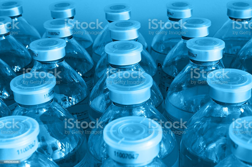 lots of identical bottle with the liquid. stock photo