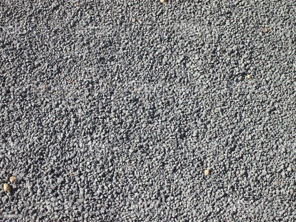 Lots of little gray gravel rocks stock photo