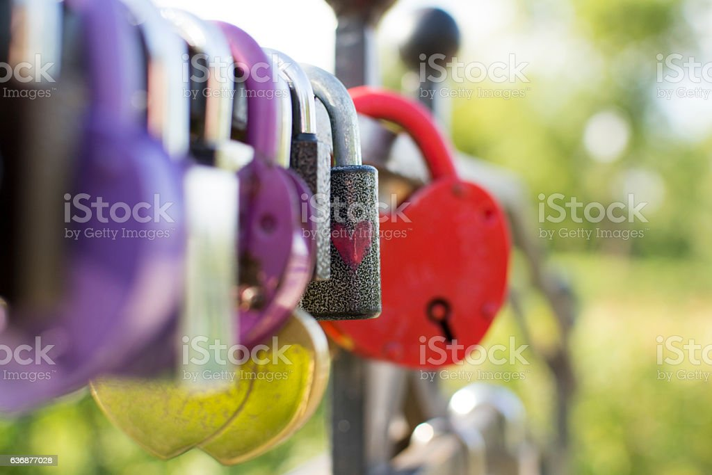 Lots of love locks on a bridge stock photo