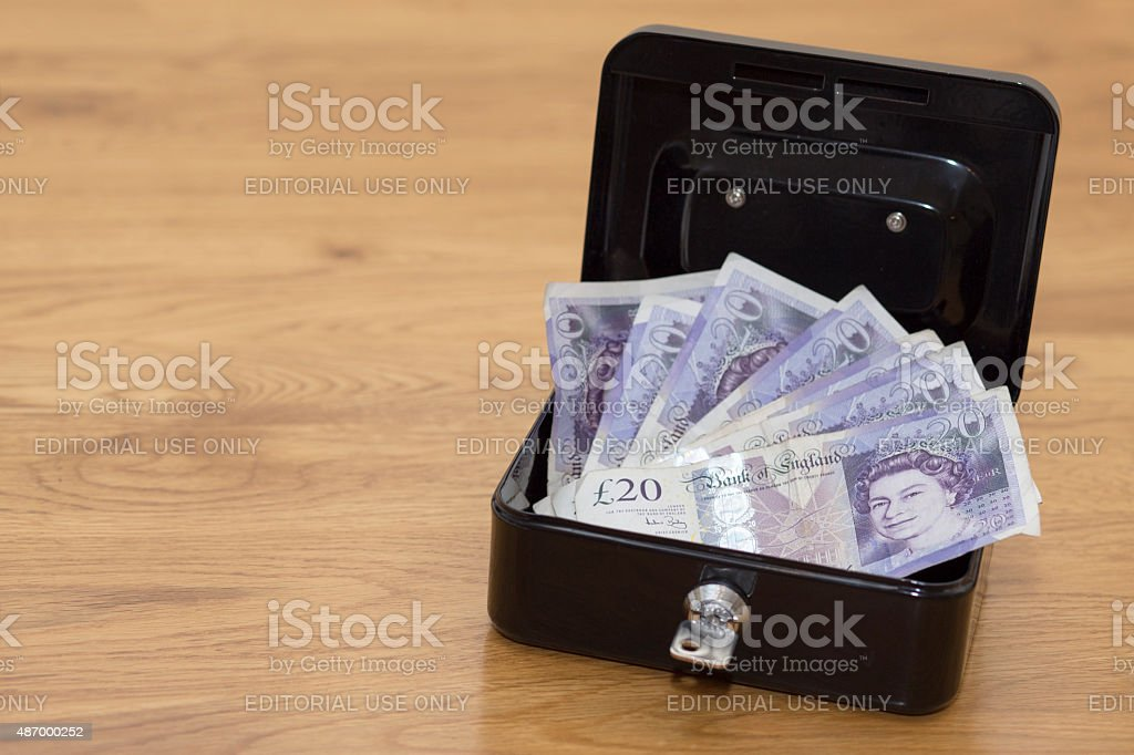 Lots of money in a safety deposit box stock photo