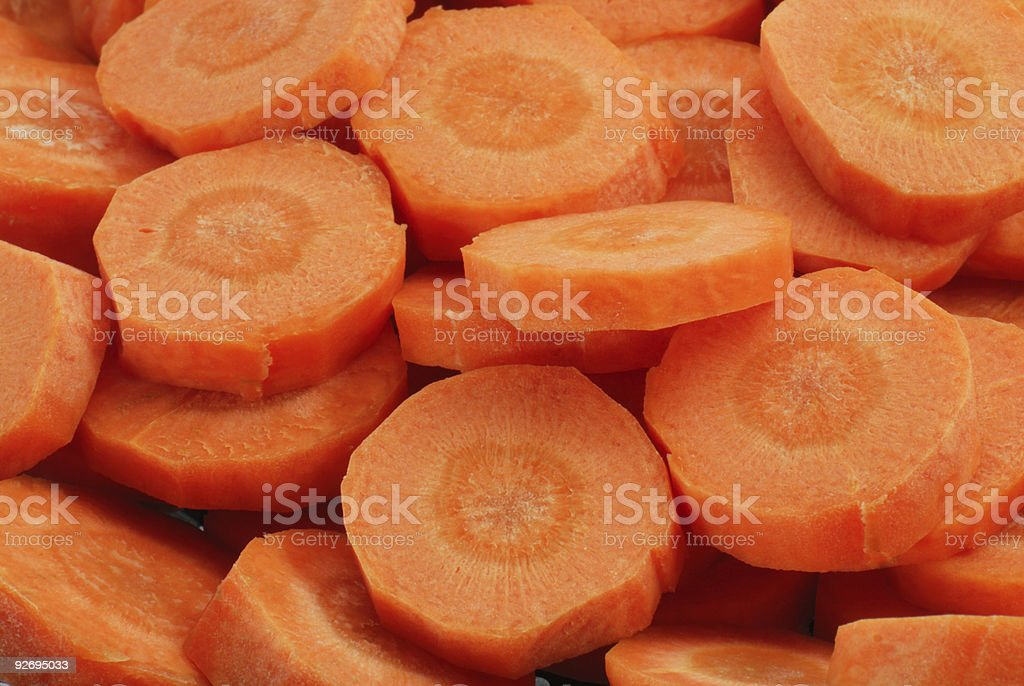 Lots of slices of fresh peeled carrots royalty-free stock photo