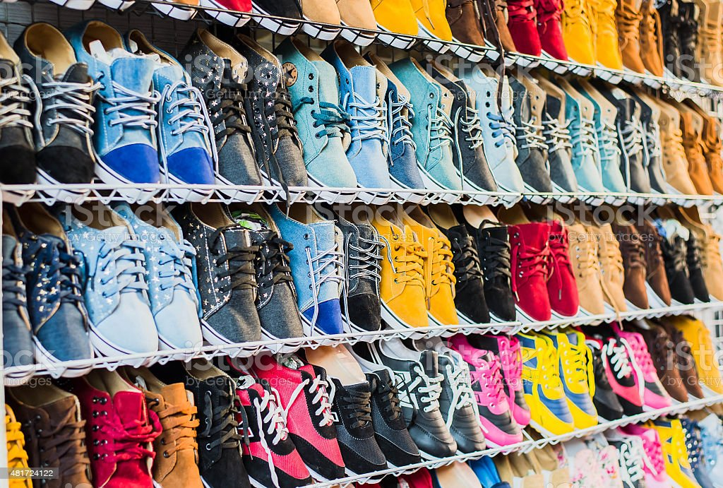 lots of sneaker shoes on sale stock photo
