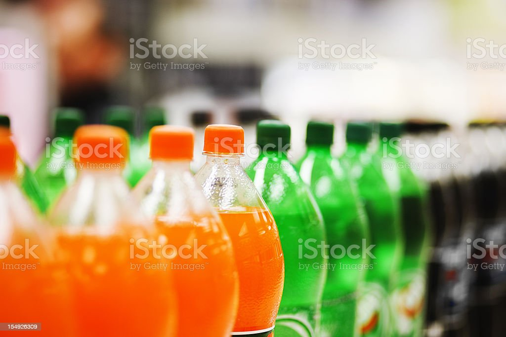 Lots of soda bottles in various flavours all lined up stock photo