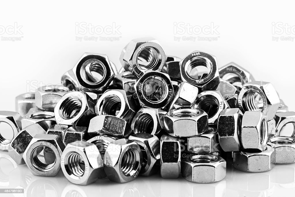 lots of steel nuts, isolated on white background stock photo