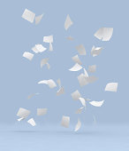 Lots of white blank papers flying with light blue background