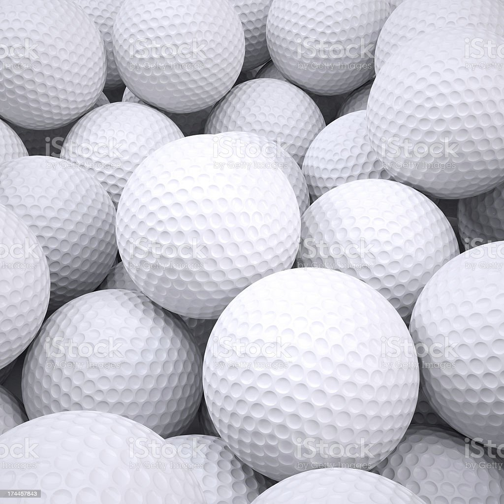 Lots of white golf balls in a basket stock photo