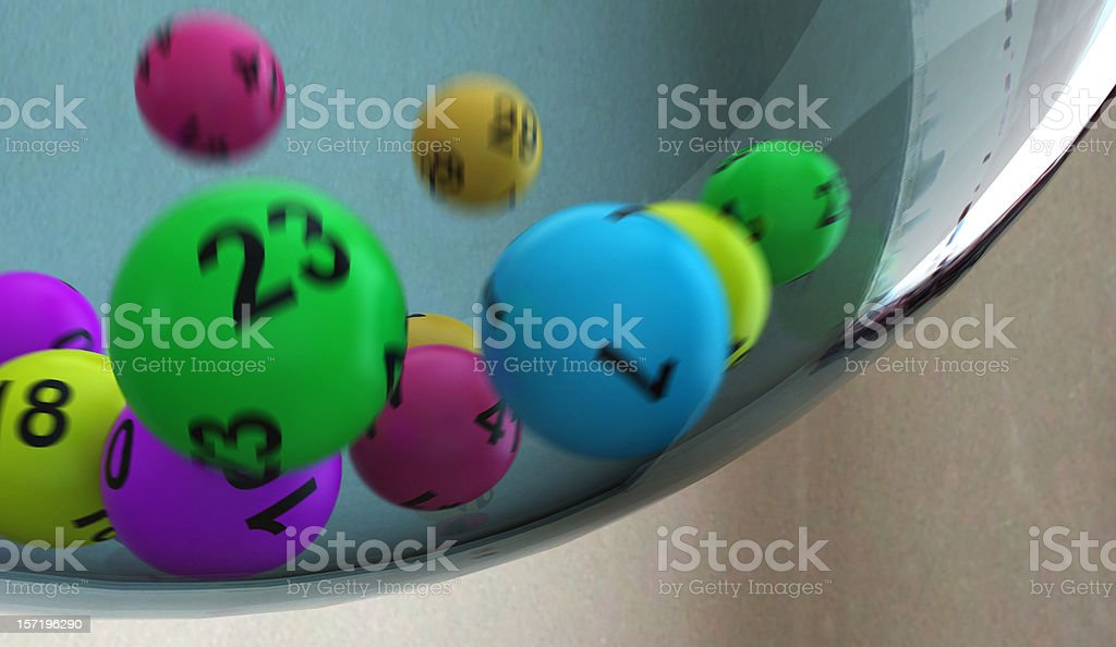 Lottery numbers rolling around in container royalty-free stock photo