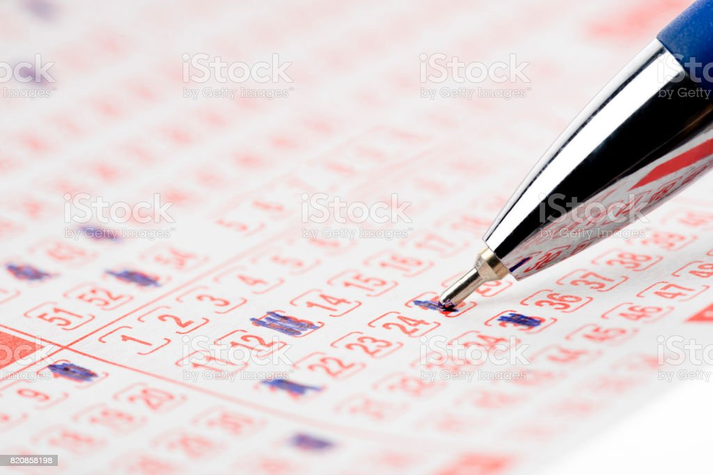 Lottery Ticket and Pen stock photo