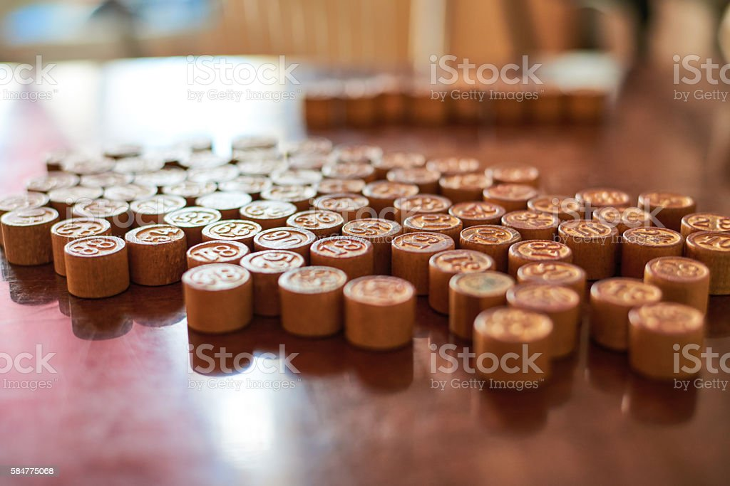 Lotto game kegs on wood board composition stock photo