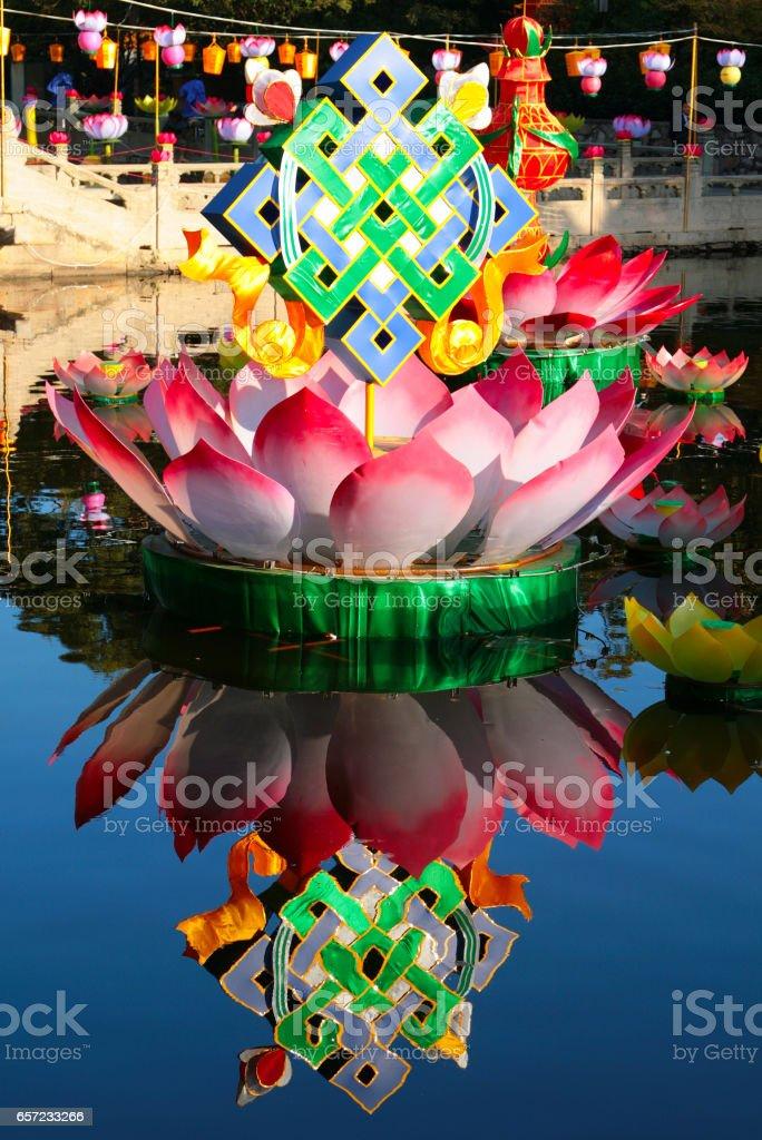 lotus and endless knot, buddhist festive decoration on the lake of Putuoshan island, Zhejiang, China stock photo