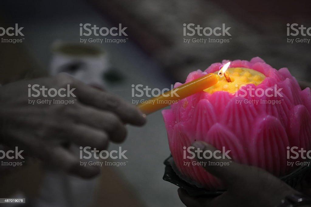 Lotus candle stock photo