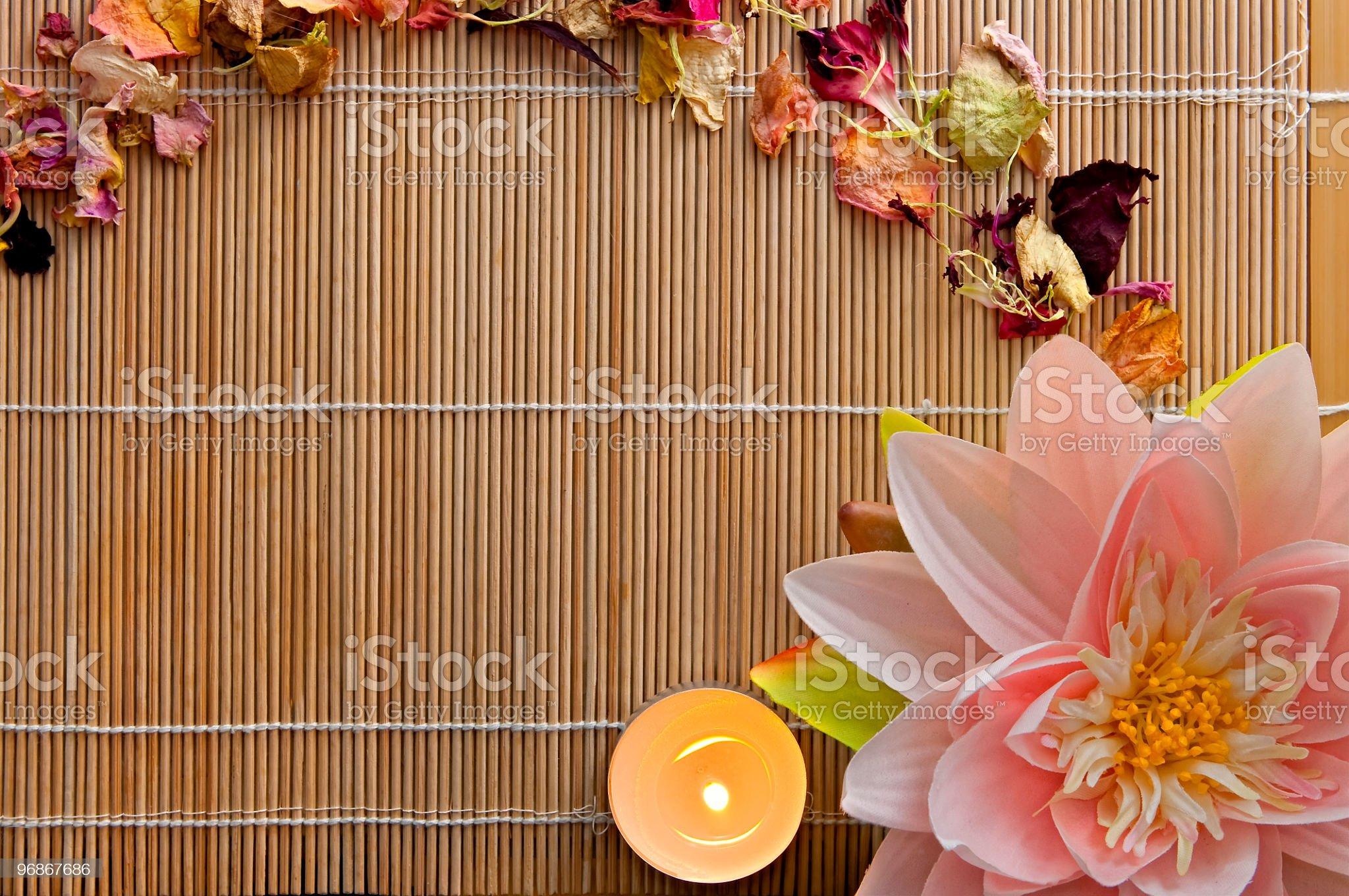 Lotus, Dried Flowers and Candle on Bamboo, with Copyspace royalty-free stock photo