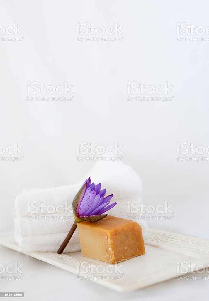 Lotus flower, natural soap and towels royalty-free stock photo