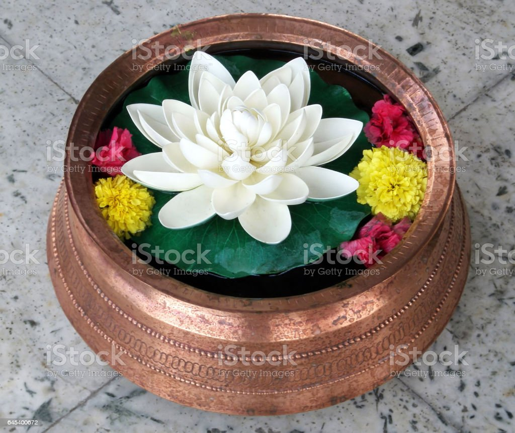 Lotus in Copper Vase with colored flowers stock photo