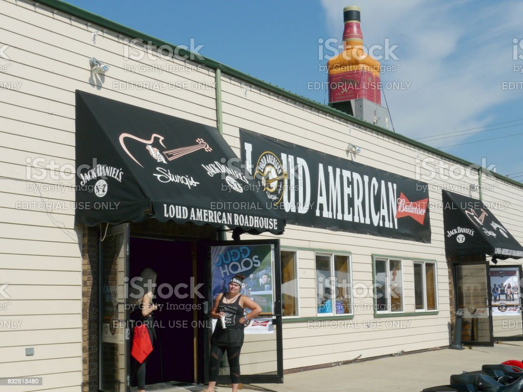 Sturgis, South Dakota - August 4, 2017: Loud American Roadhouse bar entrance with women stock photo