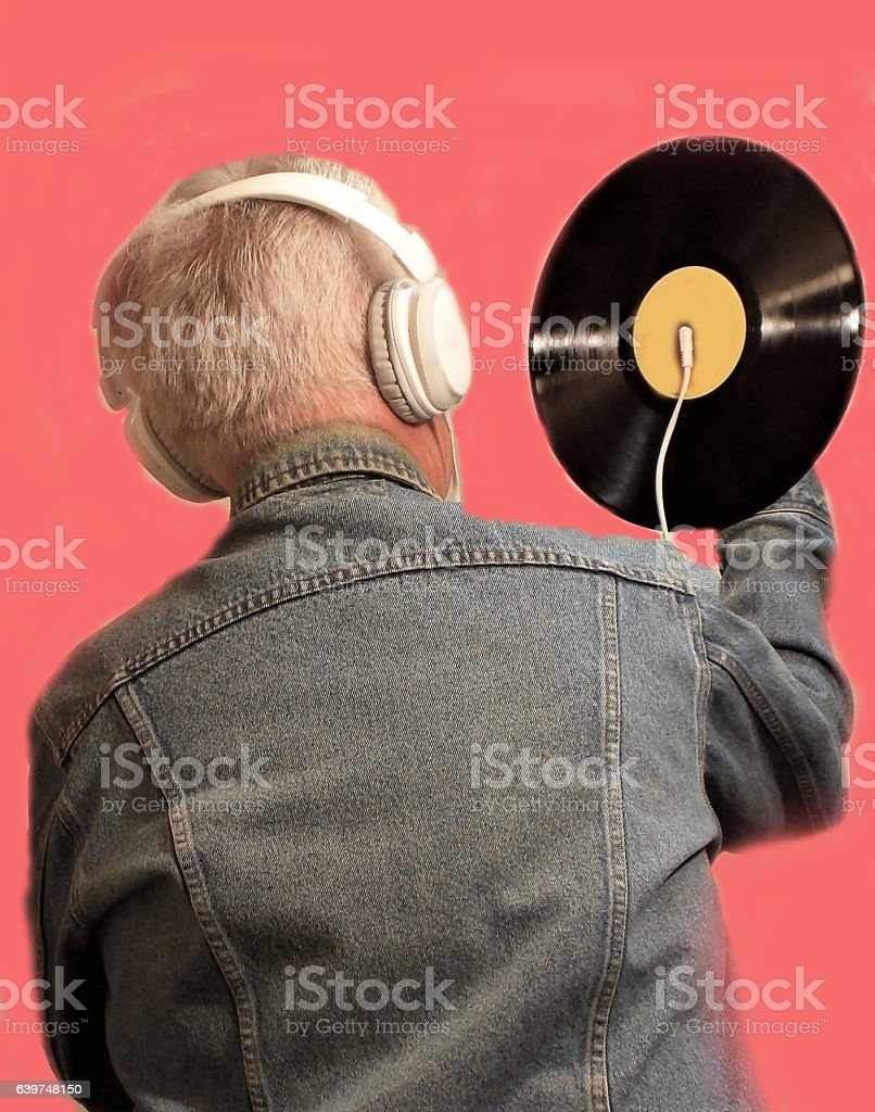Loud Music Sounds Best on a Vinyl Record wearing Headphones stock photo