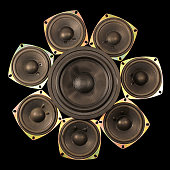 Loudspeakers - woofer and tweeters isolated on black background
