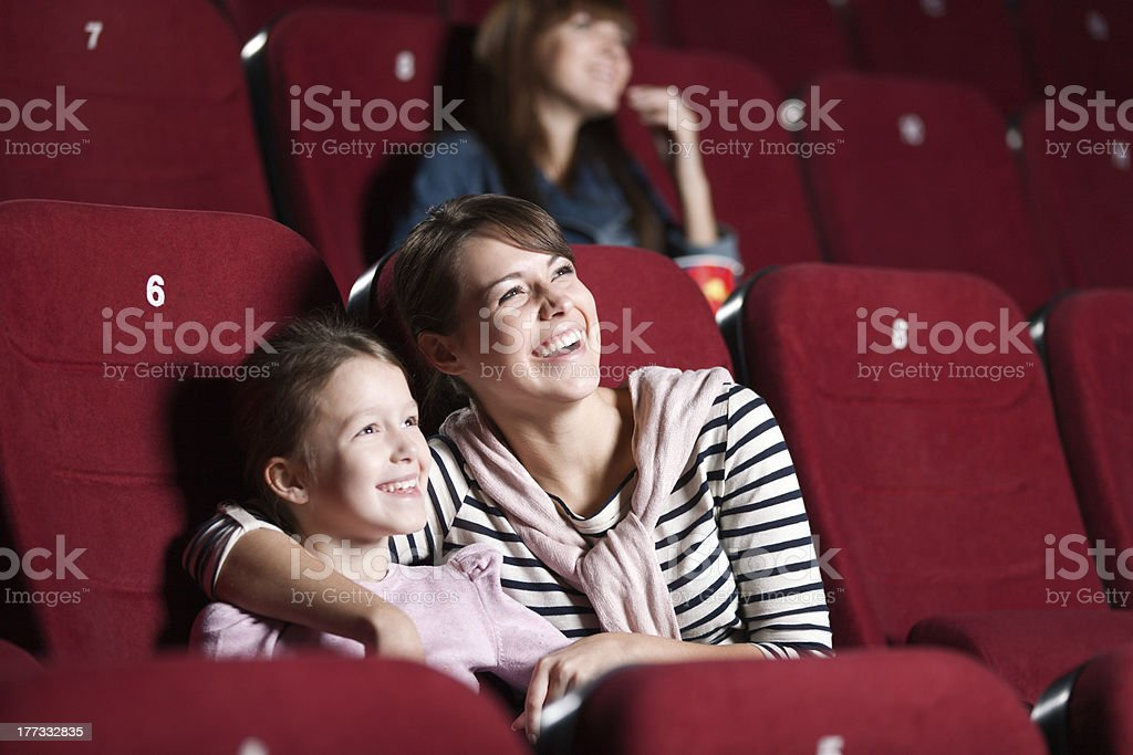 Loughing mother and daughter at the cinema royalty-free stock photo