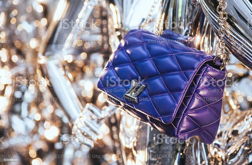 Louis Vuitton bag in a shop window in Via Montenapoleone stock photo