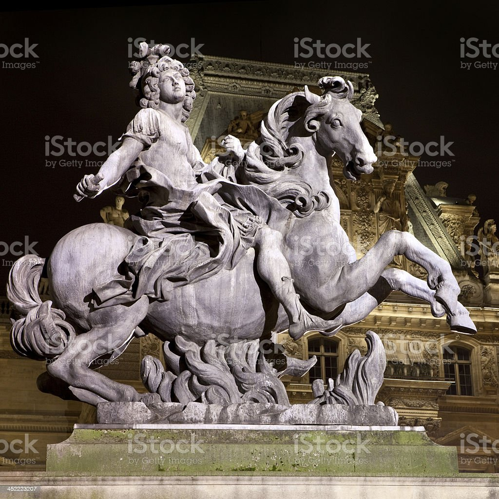 Louis XIV Statue at The Louvre in Paris stock photo