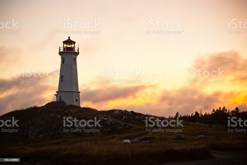 Louisbourg Lighthouse During a Summer Sunset stock photo