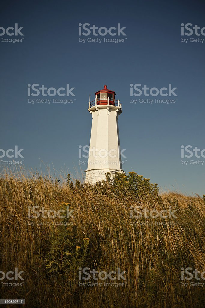 Louisbourg Lighthouse in Grass stock photo