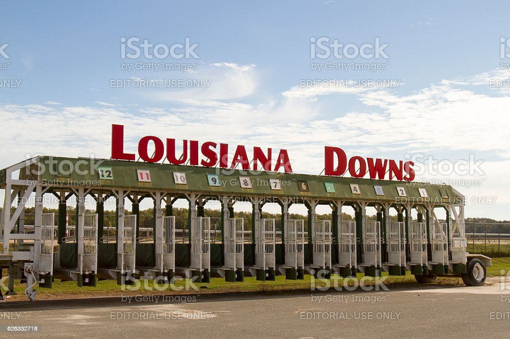 Louisiana Downs Entrance sign on starting gate stock photo