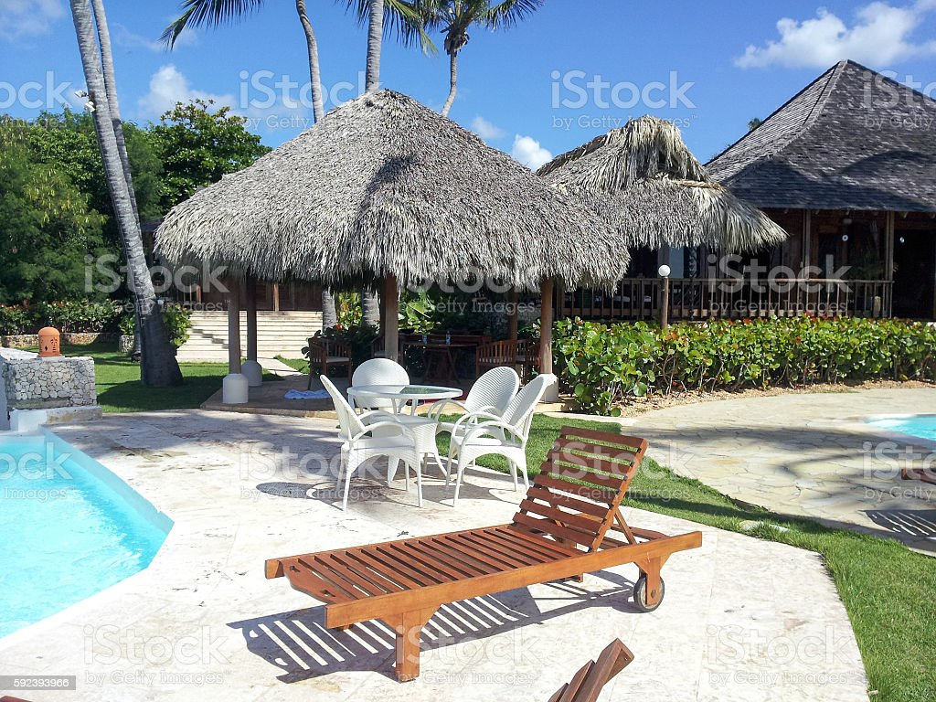 Lounge Chair and pool stock photo