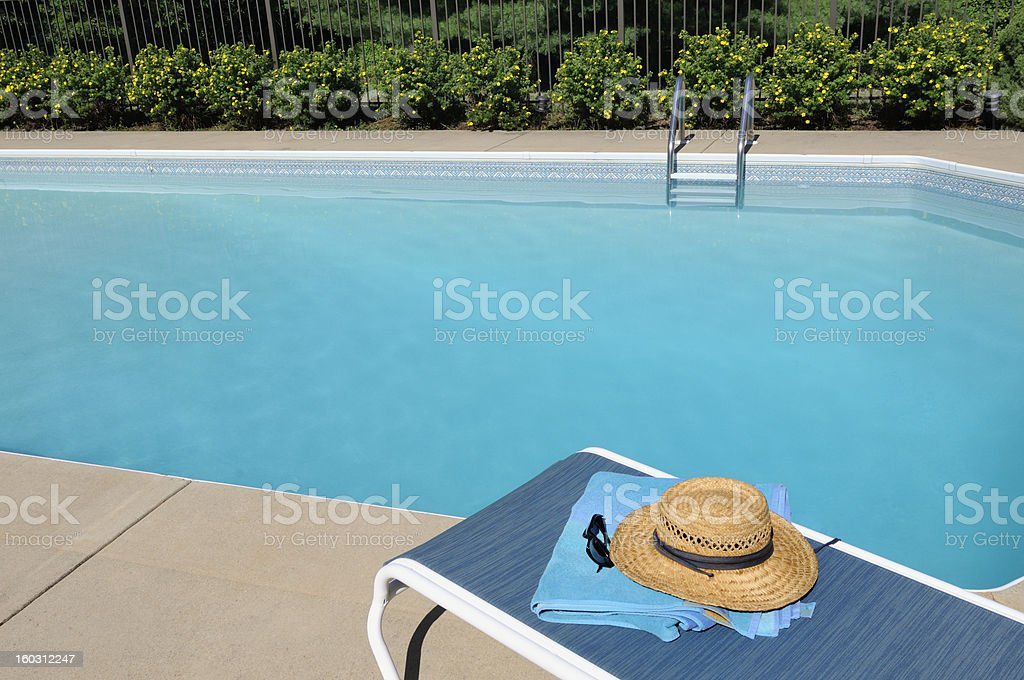 Lounge Chair by Swimming Pool stock photo