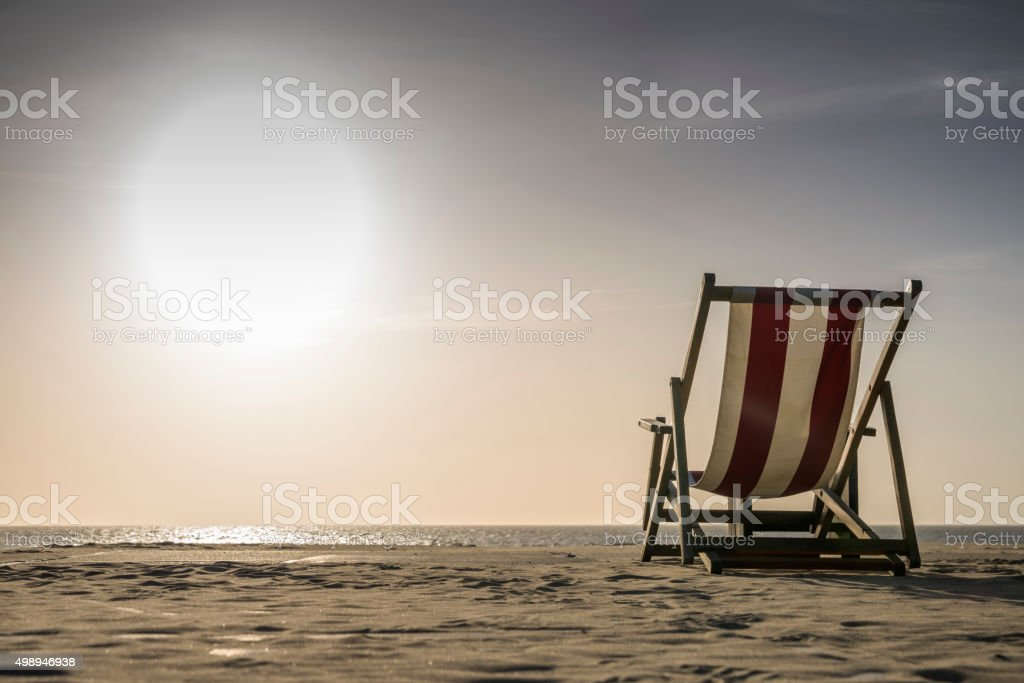 Lounge Chair on sunny day at beach stock photo