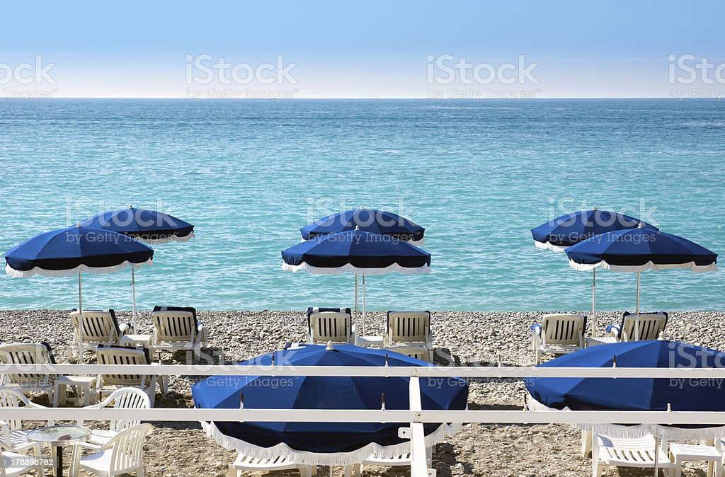 Lounge chairs and parasol royalty-free stock photo