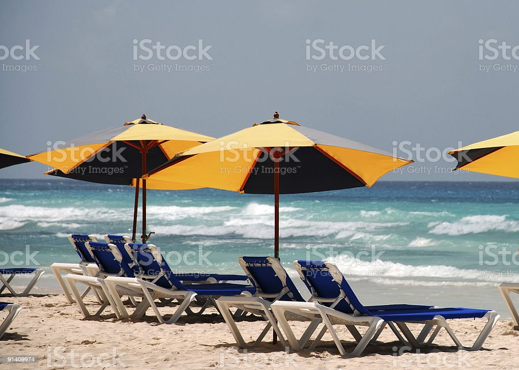 Lounge chairs and umbrellas on beach. royalty-free stock photo